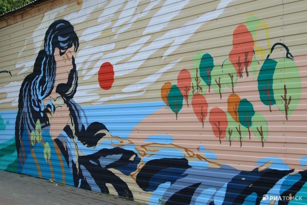 А эти изображения появились в субботу на стенах здания на улице Герцена (за Роддомом №1).